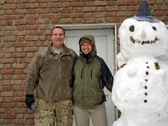 Steve & Becky beside a snowman built by the Germans; ISAF Headquarters
