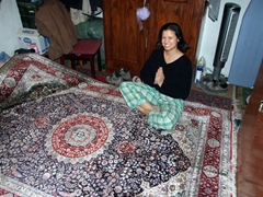 Becky strikes a silly pose on our new silk carpet, bought at a Kabul bazaar