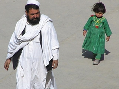 Little girl trailing her dad, Kabul
