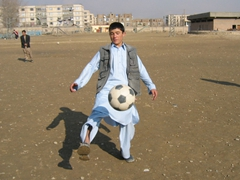 A boy shows off his soccer skills; Tahi Maskan Orphanage