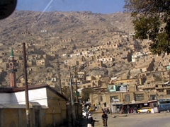 View of houses built into the mountainside; Kabul