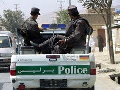A police truck patrols downtown Kabul