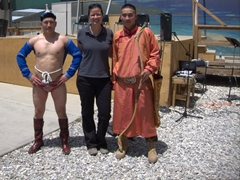 Becky strikes a pose next to Mongolian soldiers celebrating Nadaam