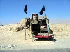 Afghan checkpoint with revered Massoud carpet