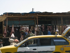 A busy Kabul street scene near the butchers section