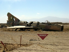Remnants of a MiG surrounded by mines, Bagram