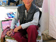 Becky promised to print a photo out for this friendly Afghan boy after he posed for a photo; Kabul bazaar