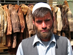 Portrait of a fur jacket vendor; Kabul bazaar