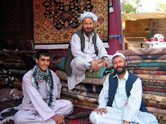 A portrait of carpet vendors; Kabul bazaar