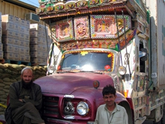 Afghans pose beside their jingle truck