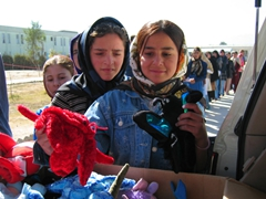 Girls lined up to receive stuffed toys; Allahuddin Orphanage