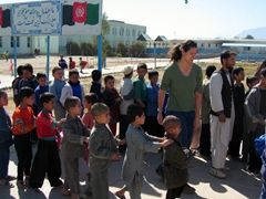 Becky at the Allahuddin Orphanage getting the boys organized to receive donations of toys and kites