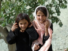 The girl on the left will not be allowed to remain uncovered with a head scarf for much longer; Paghman Village