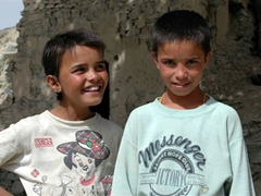 These Paghman village boys proudly wear their donated clothes