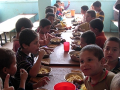 Boys chowing down at Allahuddin Orphanage