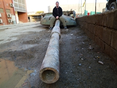 Robby sitting on a Russian tank recently discovered buried on ISAF Headquarters