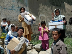 The children of Paghman village are super excited to receive donated boxes of toys and clothing