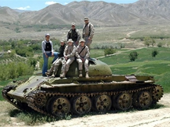 Becky and some friends climb aboard a decrepit Russian tank nearby Paghman village. The surrounding scenery is absolutely stunning and a visit to beautiful Paghman is a must in the springtime!