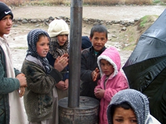 The children of Paghman village were all huddled around this stove pipe in an effort to stay warm. Little do they realize the dangers of the stove pipe; we saw far too many burns at the hospital ward that makes us really sad that the populace isn't more educated on the dangers of heat and fire
