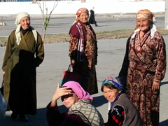 Uzbek women in a huddle before their shopping spree smile when they notice us at the Tashkent Chorsu (main bazaar market)