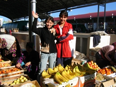 A friendly Uzbek girl greets us at the main market in Tashkent