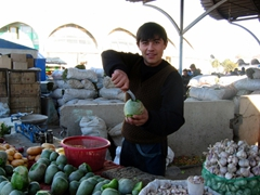 A friendly vendor at the Tashkent Chorsu poses for a photo