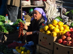 An Uzbek woman waiting patiently to make a sale; Tashkent Market