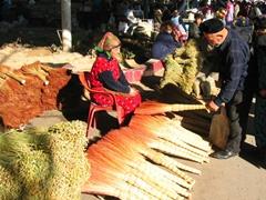 An Uzbek man examines a potential broom; Tashkent main market