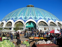 The massive, blue domed Chorsu Bazaar, built by the Soviets to replace a maze of covered stalls; Tashkent