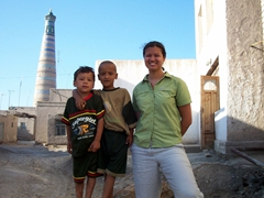 Friendly Khiva boys posing with Becky in the old city