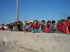 School kids atop wall, Khiva Old City