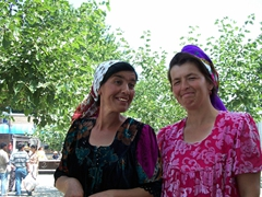 Uzbek women laughing self-consciously at their picture being taken
