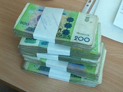 A large stack of Uzbek som (their largest note is a 1000 som, which is equivalent to 50 cents!)
