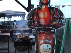 A lolo BBQ pit showcases the fare on offer… plus a beckoning Jumbie Rum advertisement
