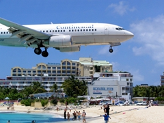 This is no photoshopped image; the plane is literally about to touch down at Juliana Airport