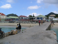 Locals chilling by the pier in Grand Case