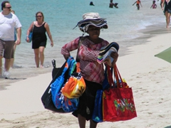 Bags, hats, and more bags for sale by an entrepreneurial businesswoman on Philipsburg Beach