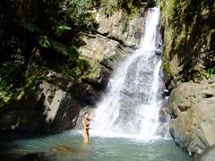 Becky strikes her best Vanna White pose; La Mina Falls