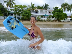 Becky goes boogie boarding in Rincon