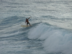 A surfer tries to stay upright; Rincon