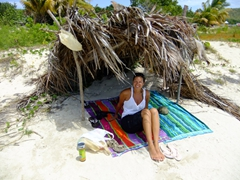 Becky is all smiles after she snags a pre-built shady shack on Bahia de la Chiva