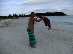 Robby shaking the sand from our beach towels; Playa Caracas
