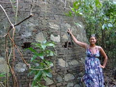 "Becky stands next to a portion of ""La Central Playa Grande"", an old sugarcane plantation mill that closed down in 1942"