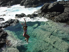 "Becky jumps into one of Playa Tortuga's ""baths""; Culebrita"