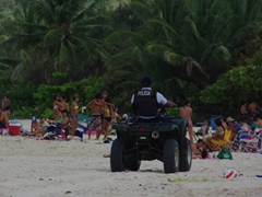 What a miserable job to have during Spring Break! The beach police attempt to keep the party-goers under control at Flamenco Beach