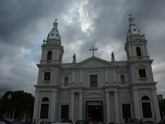Storm clouds are moving in towards Ponce Cathedral, which lies in the middle of Ponce's town square