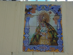 Religious tilework is seen outside several Ponce houses