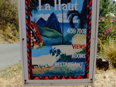 Sign for La Haut hotel/restaurant; near Soufriere Bay