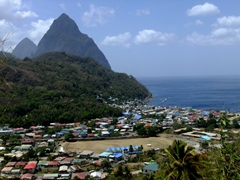 "The majestic twin peaks commonly referred to at ""the pitons"" with pretty Soufriere Bay in the foreground"