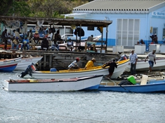 Local fishermen pulling their boats in; Castries Harbor